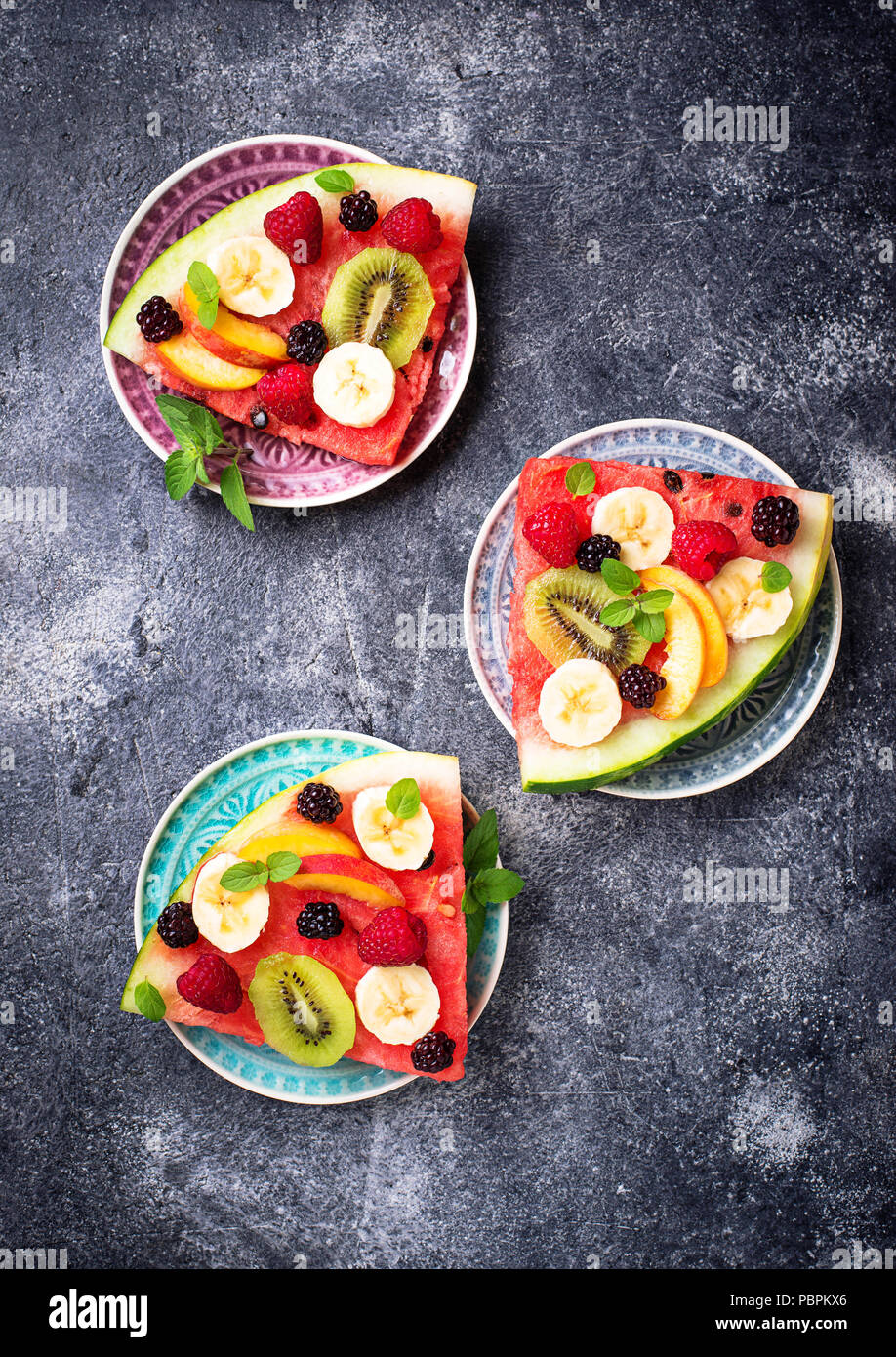 Watermelon pizza with fruit and berries. Healthy summer dessert - Stock Image
