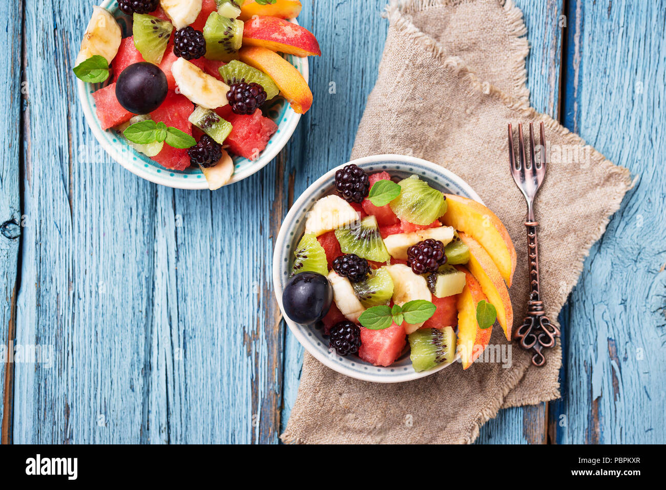 Fruits salad with watermelon, banana, kiwi and berries - Stock Image