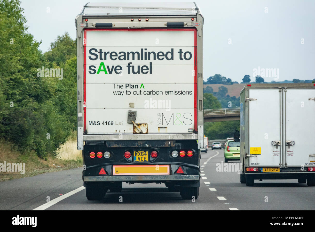 A Marks and Spencer lorry promoting reducing carbon emissions on a motorway, England, UK - Stock Image