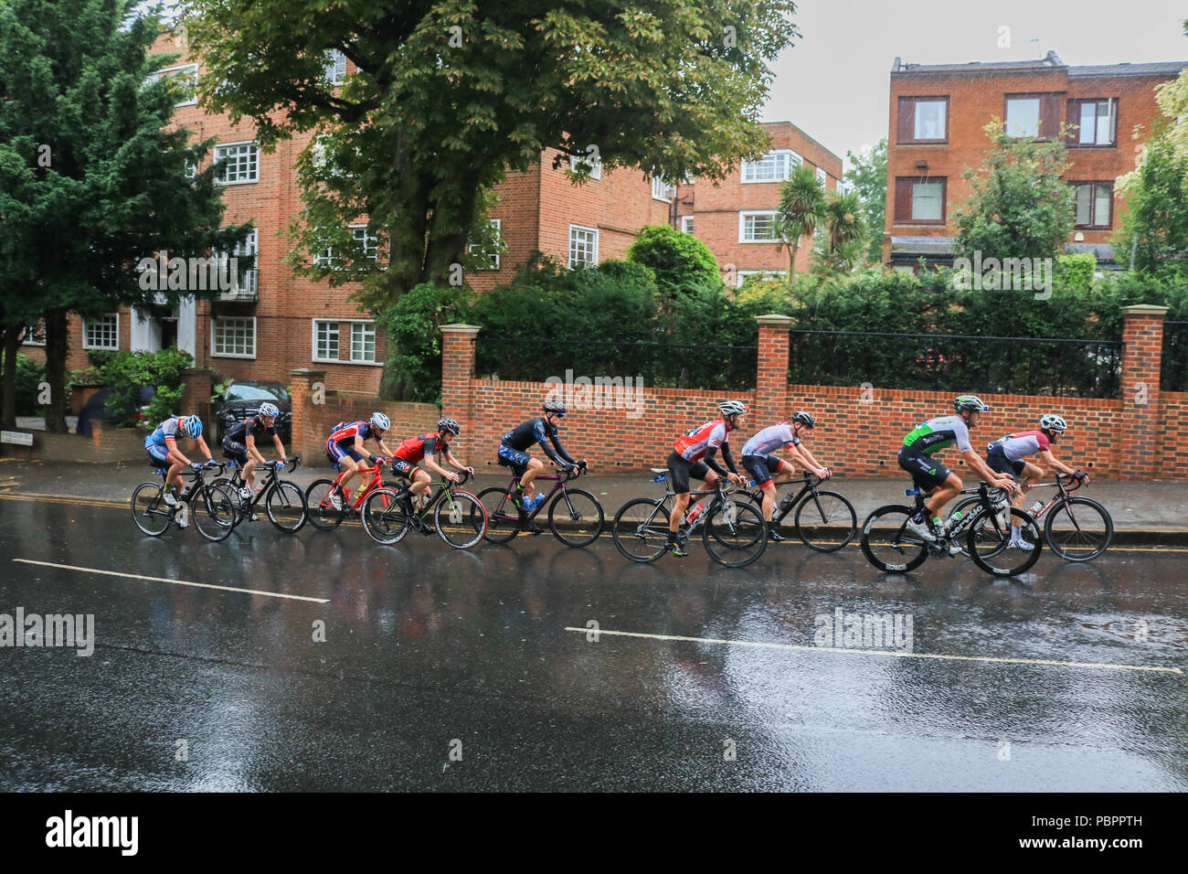 Cyclists pass through Wimbledon village in the Prudential London Surrey 100  classic event in wet conditions as the rains start to come down. 02f5c6a0d