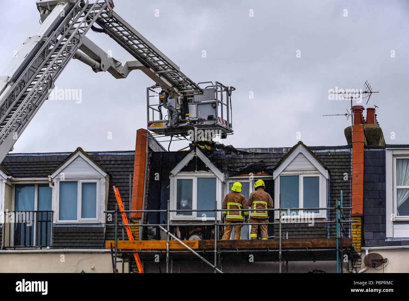 Eastern Esplanade, Southend on Sea, Essex, UK. Five fire engines, ambulances and police attended a flat fire in Southend. The seafront road was closed during the incident. The cause of the fire was reported to be accidental, due to works being carried out - Stock Image