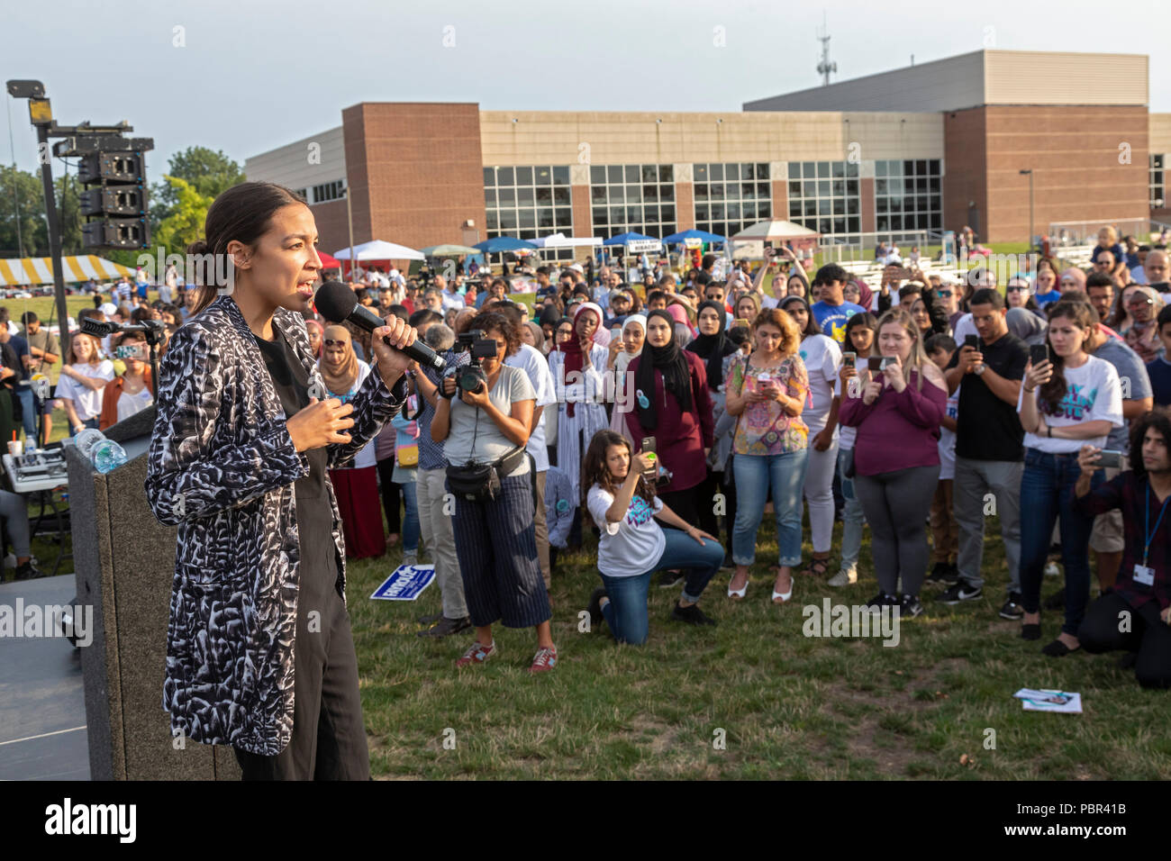 Dearborn, Michigan USA - 29 July 2018 - Alexandria Ocasio-Cortez speaks at a Muslim Get Out the Vote rally, sponsored by several Muslim community organizations. Ocasio-Cortez is the Democratic candidate for Congress in New York's 14th District, having upset incumbent Joe Crowley. Credit: Jim West/Alamy Live News - Stock Image