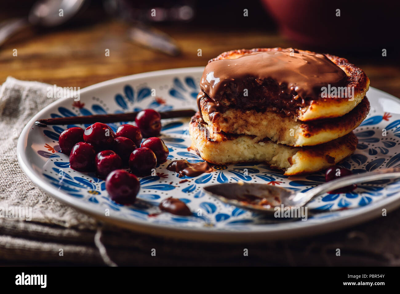 Quark Pancakes with Hazelnut Paste, Frozen Cherry and Vanilla Pod. - Stock Image
