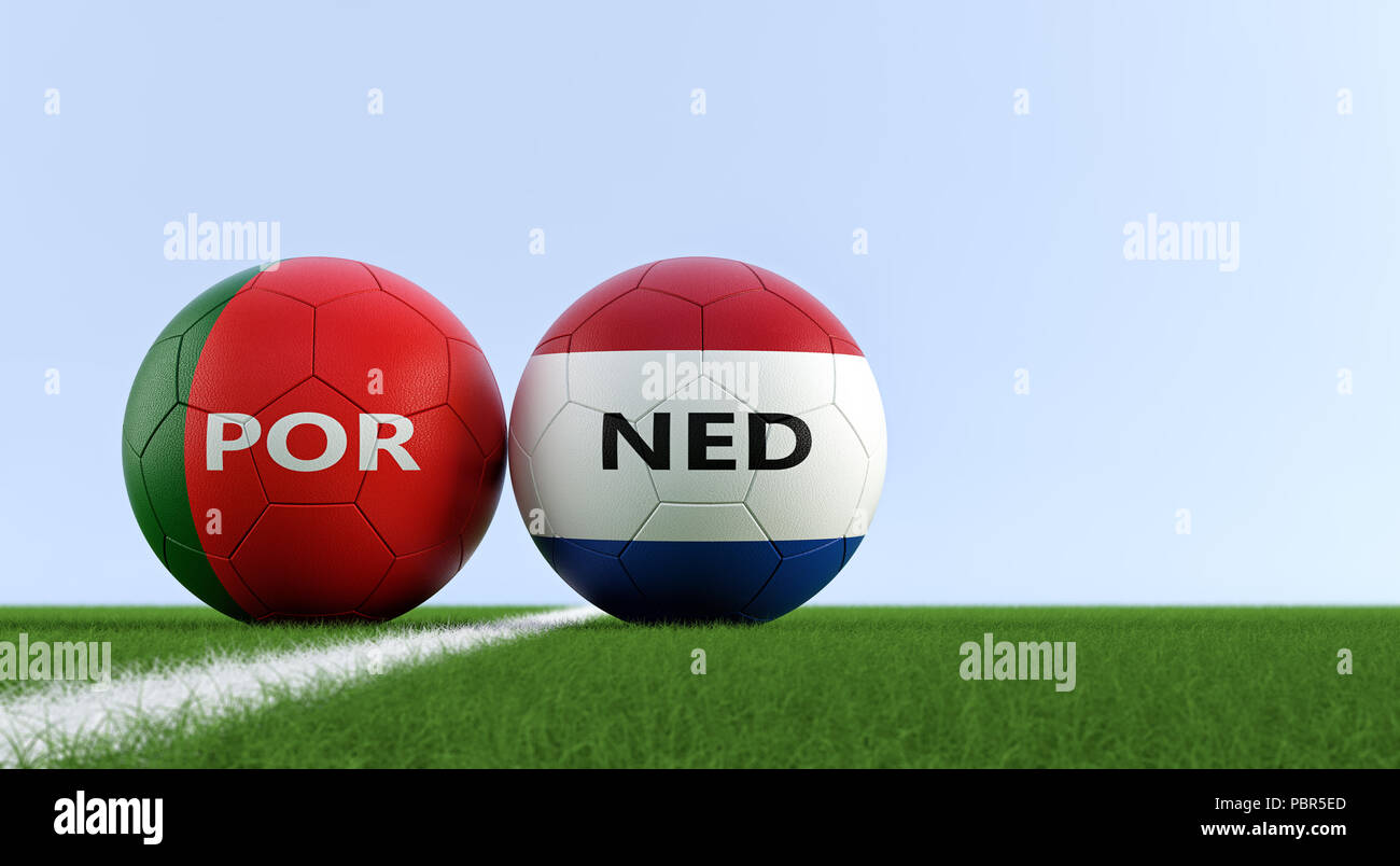 Portugal vs. Netherland Soccer Match - Soccer balls in Portugal and Netherlands national colors on a soccer field. Copy space on the right side - Stock Image