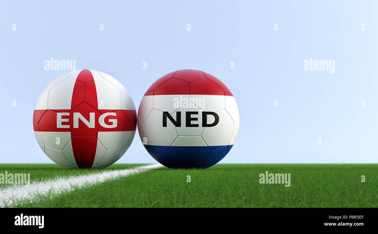 England vs. Netherland Soccer Match - Soccer balls in England and Netherlands national colors on a soccer field. Copy space on the right side - Stock Image