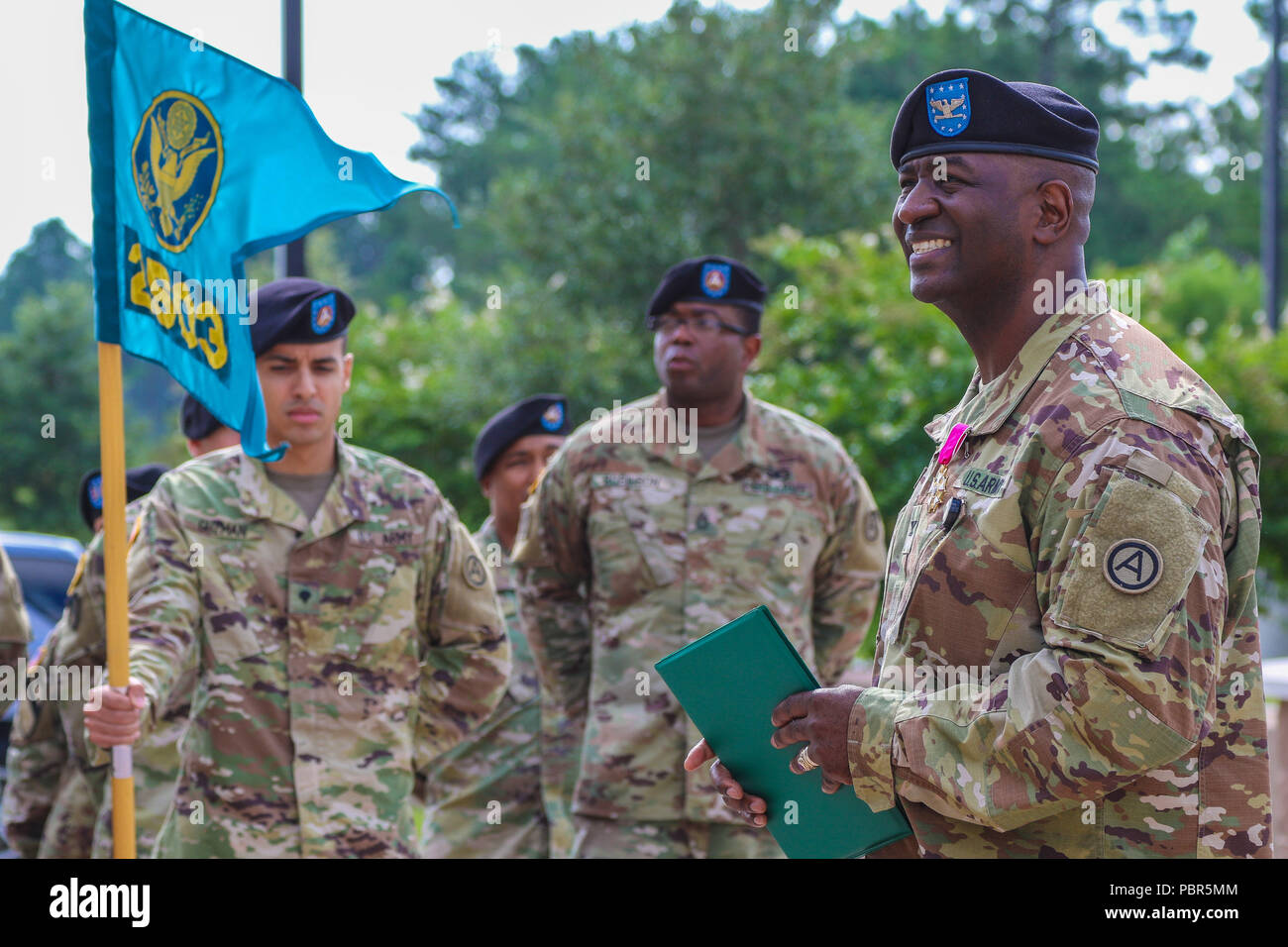 Col. Oscar W. Doward Jr., outgoing commander of the 2503rd Digital Liaison Detachment, U.S. Army Central, speaks to the audience during his award presentation prior to his change-of-command ceremony July 19, 2018, at USARCENT headquarters on Shaw Air Force Base, S.C. (U.S. Army photo by Sgt. Von Marie Donato) Stock Photo