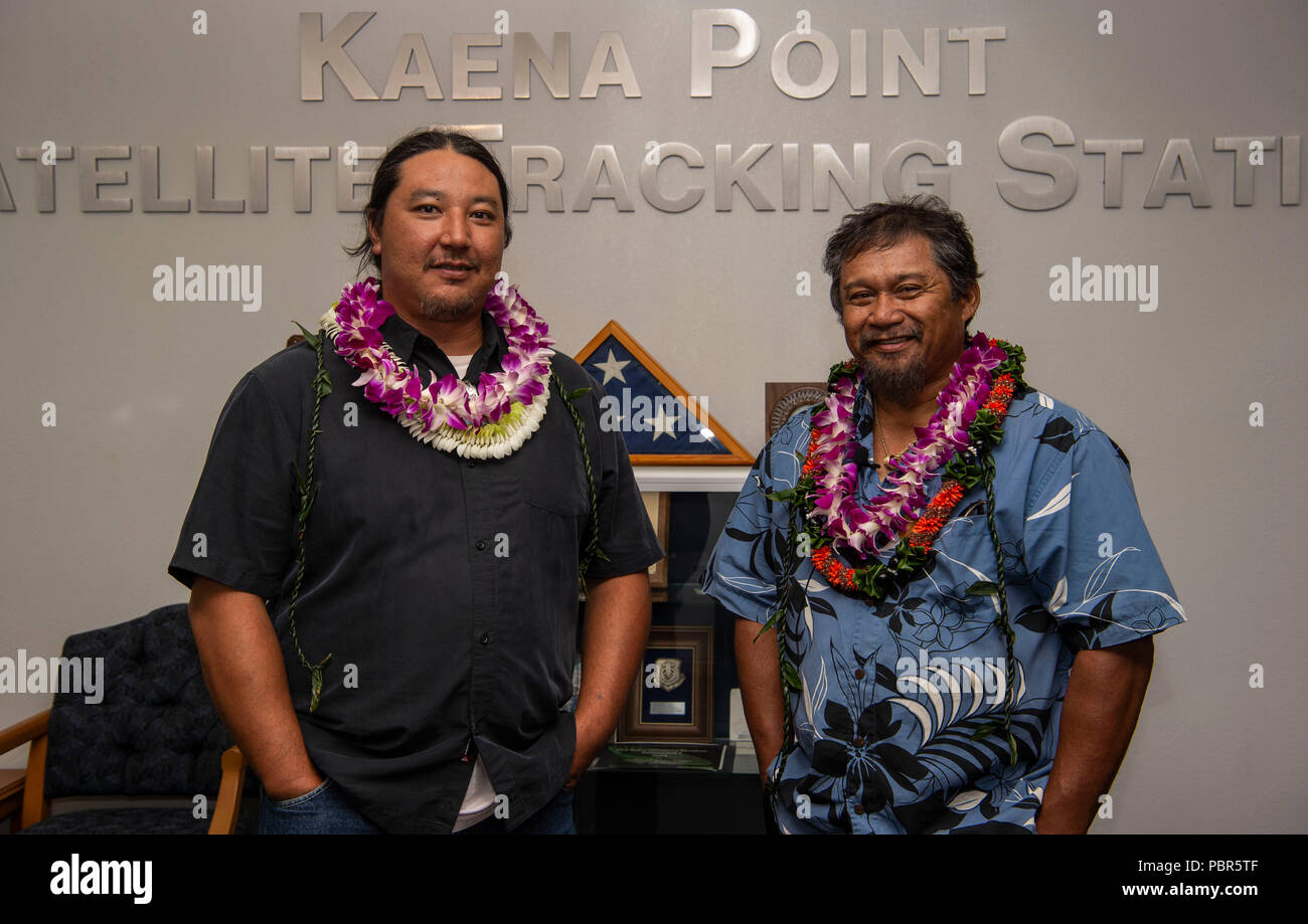 Jason Fukumoto, Detachment 3, 21st Space Operations Squadron electrician, and Robin Albios, Det. 3, 21st SOPS heating, ventilation and air conditioning specialist, pose for a photo after receiving the Air Force Civilian Award for Valor at the Kaena Point Satellite Tracking Station, Hawaii, July 23, 2018. Two years ago, Fukumoto and Albios provided medical aid to a state of Hawaii volunteer field crew member who suffered from smoke inhalation during a fire at the Kuaokala Game Management Area. (U.S. Air Force photo by Tech. Sgt. Heather Redman) - Stock Image