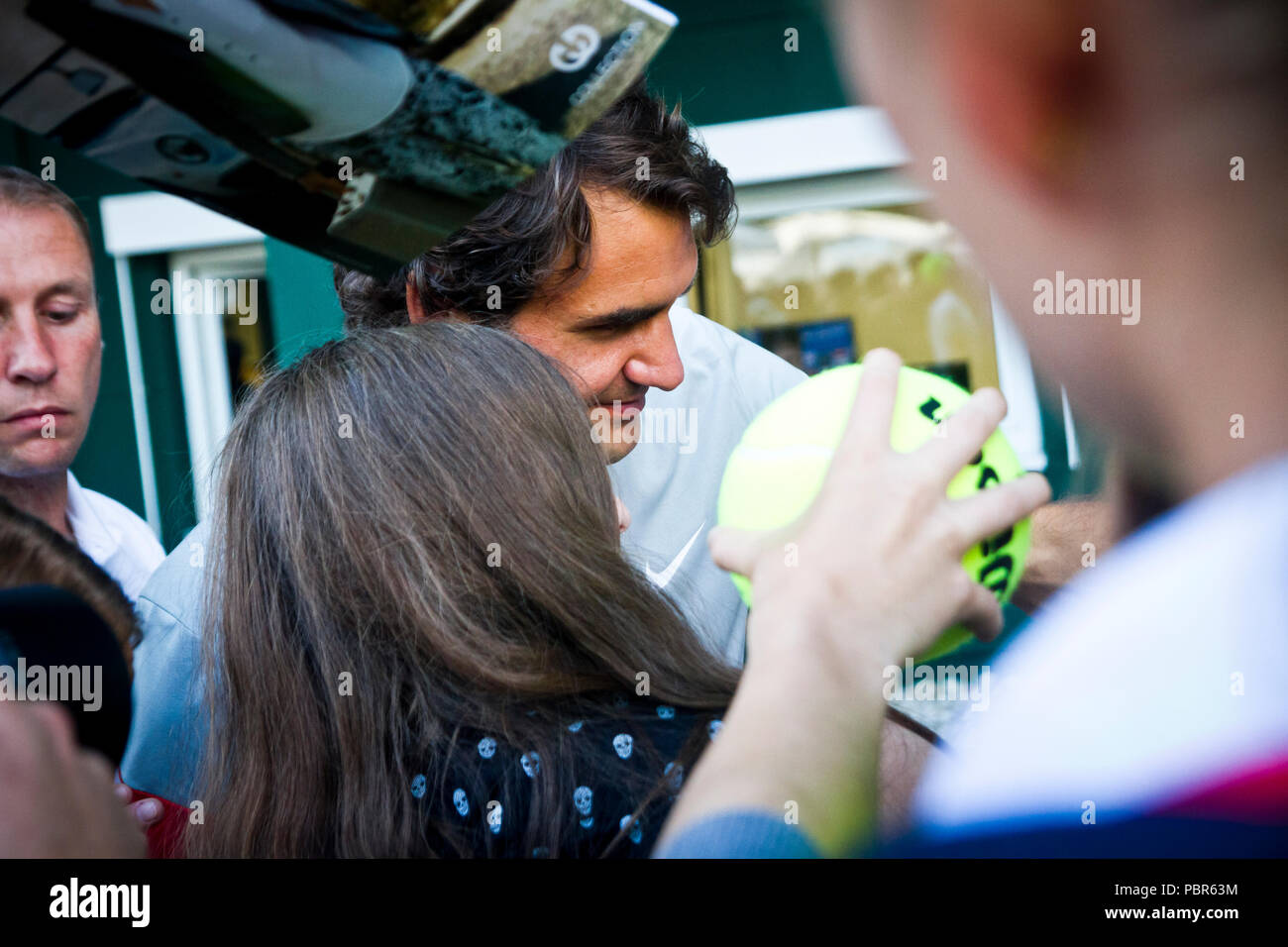 Roger Federer signs autographs for fans at the 2013 Gerry Weber Open in  Halle (Westfalen f97db03e8dd3