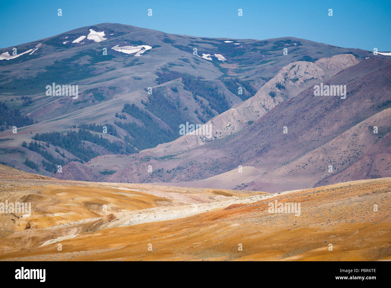 Mountain landscape, red-orange color, reminiscent of the color of the surface of the planet Mars. The Republic of Altai, Russia. - Stock Image
