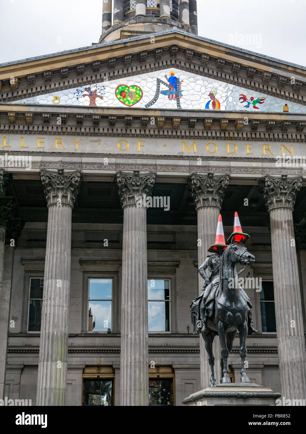 Equestrian statue Duke of Wellington with traffic cones, Gallery of Modern Art, GoMA, Royal Exchange Square, Glasgow, Scotland, UK - Stock Image