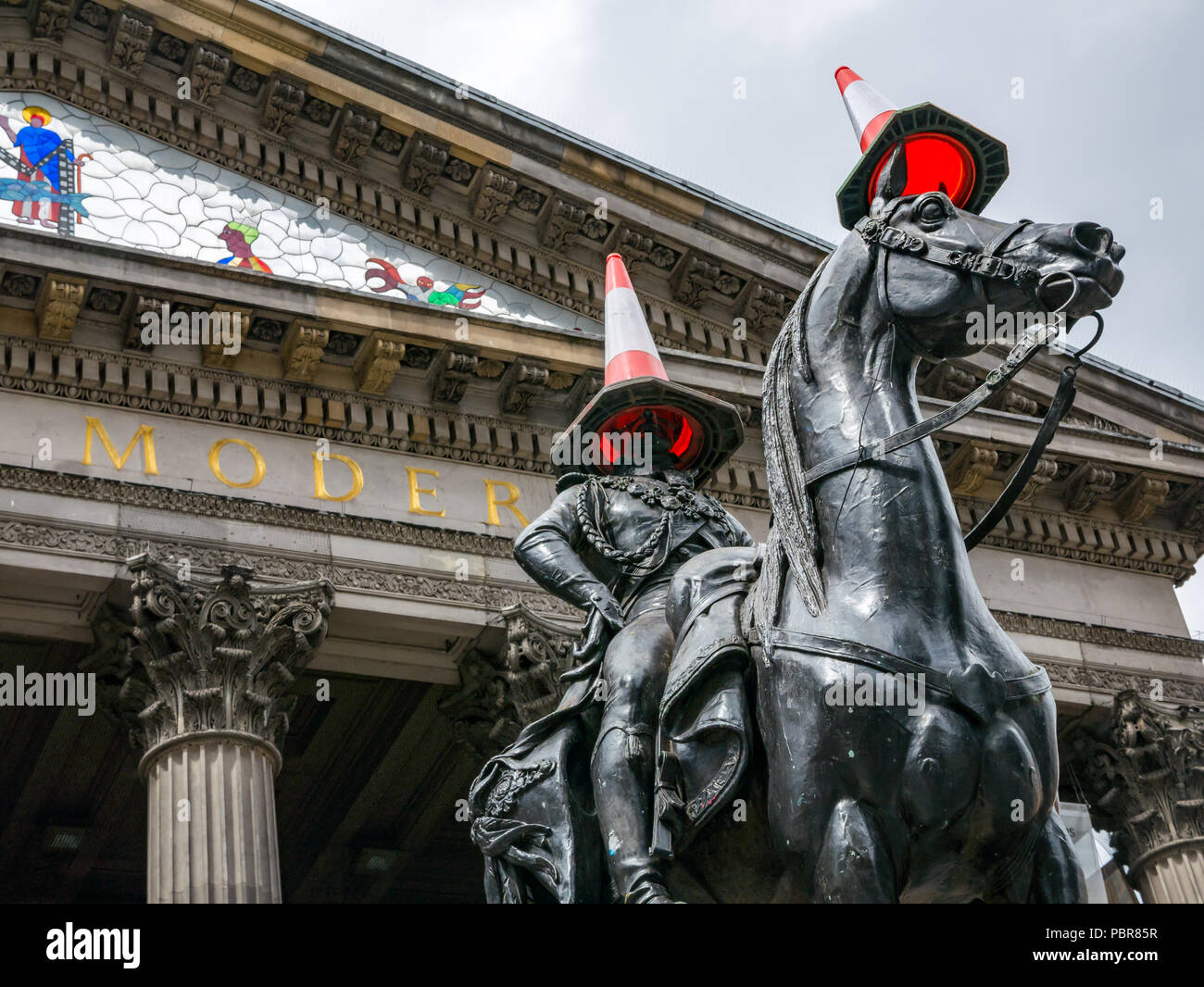 Duke of Wellington statue by Carlo Marochetti with traffic cones, Gallery of Modern Art, GoMA, Royal Exchange Square, Glasgow, Scotland, UK - Stock Image
