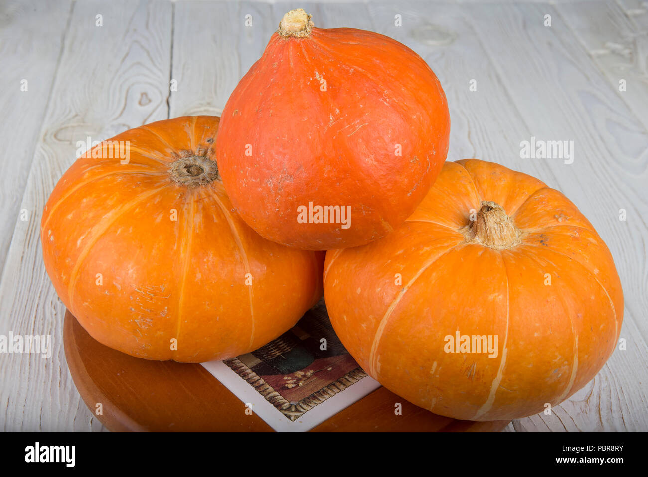 Ripe fresh pumpkin. On a wooden table Stock Photo