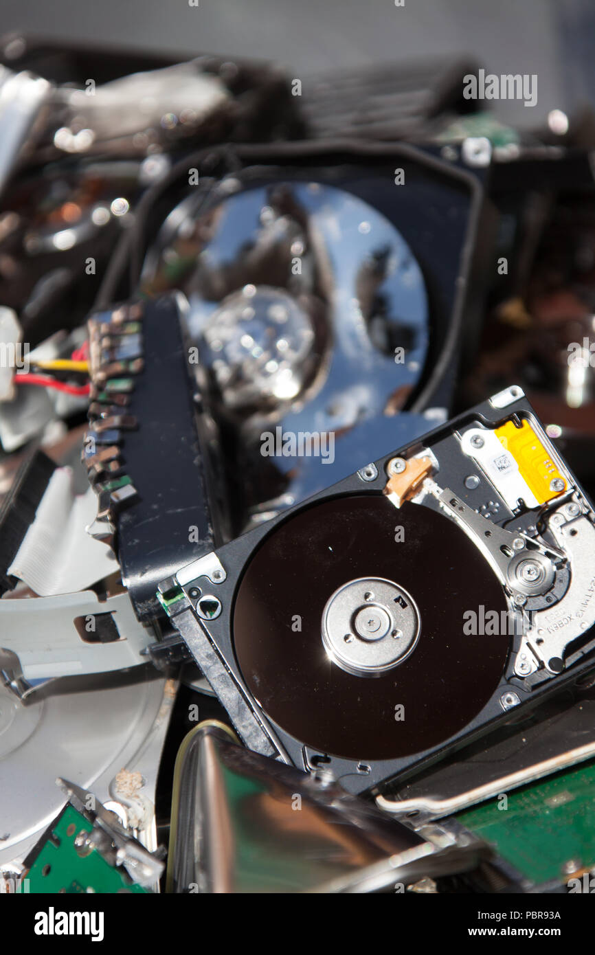 Batch of redundant IT equipment, which has been destroyed for data security purposes. - Stock Image