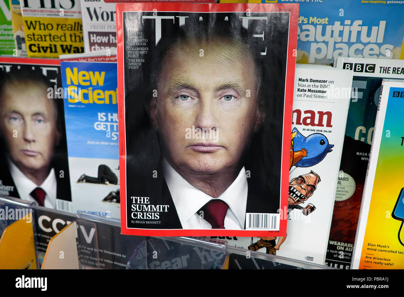 Time magazine cover July 2018 Vladimir Putin and Donald Trump portrait blend with other magazines on newsagent shelf WH Smith London UK  KATHY DEWITT - Stock Image