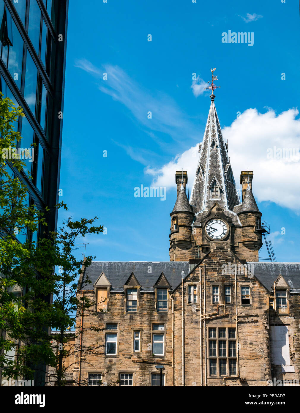 Old and new buildings at Quartermile conversion of former Royal Infirmary, with Gothic clock tower, Edinburgh, Scotland, UK - Stock Image
