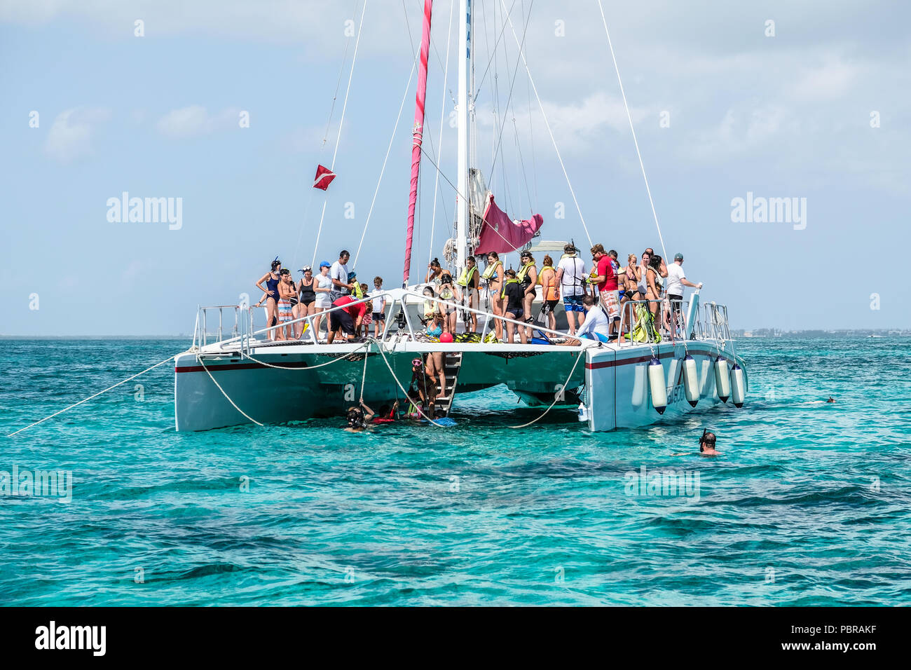 Red Sail Sports sail boat at Stingray City off Grand Cayman Island - Stock Image
