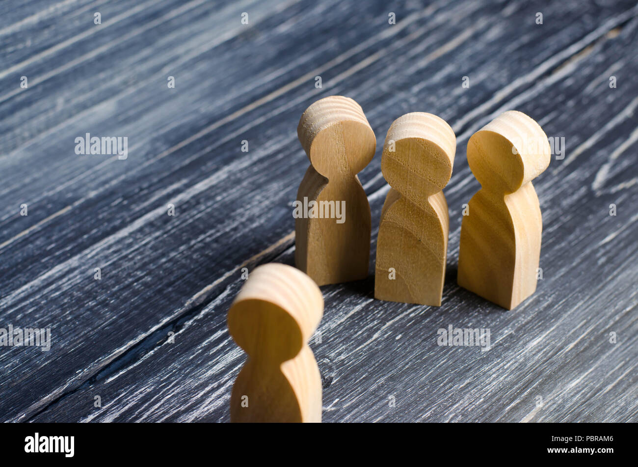Three people meet one. Three people are aggressively attuned to one. People conduct an interview and a meeting. The concept of attack, threats, encoun - Stock Image