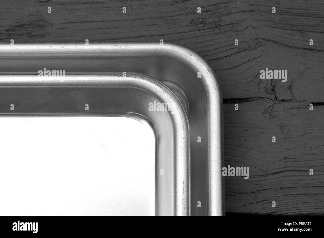 Close up of tray on wood in black and white - Stock Image