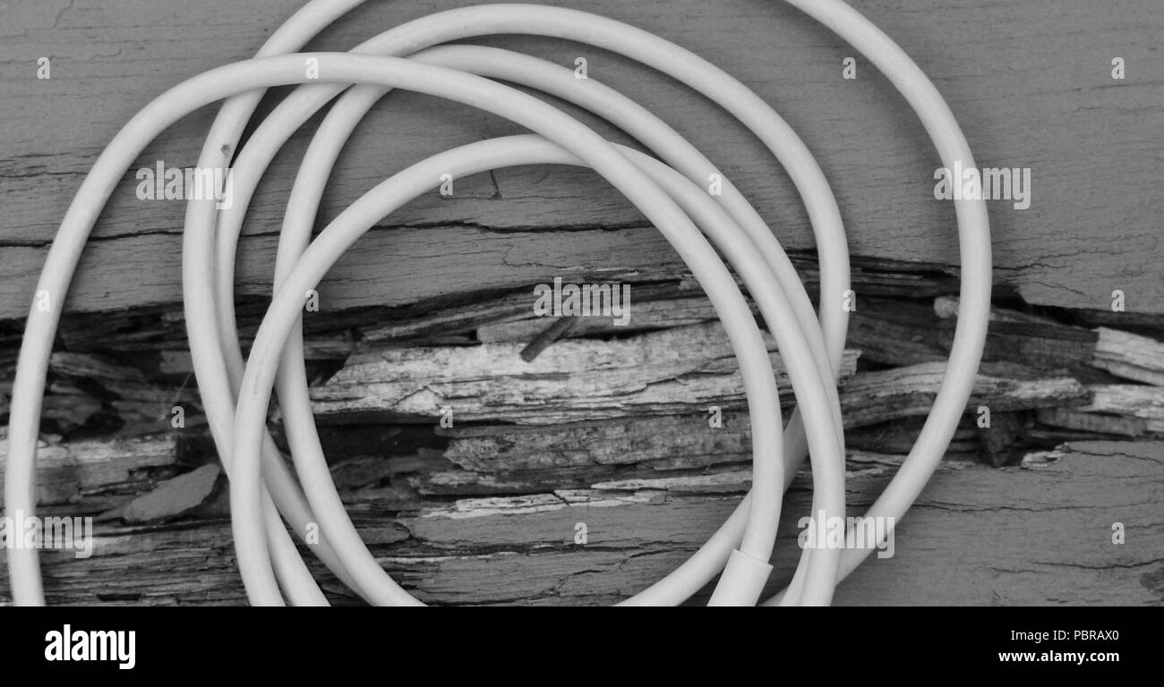 Electrical Wire on top of Wood in Black and White - Stock Image
