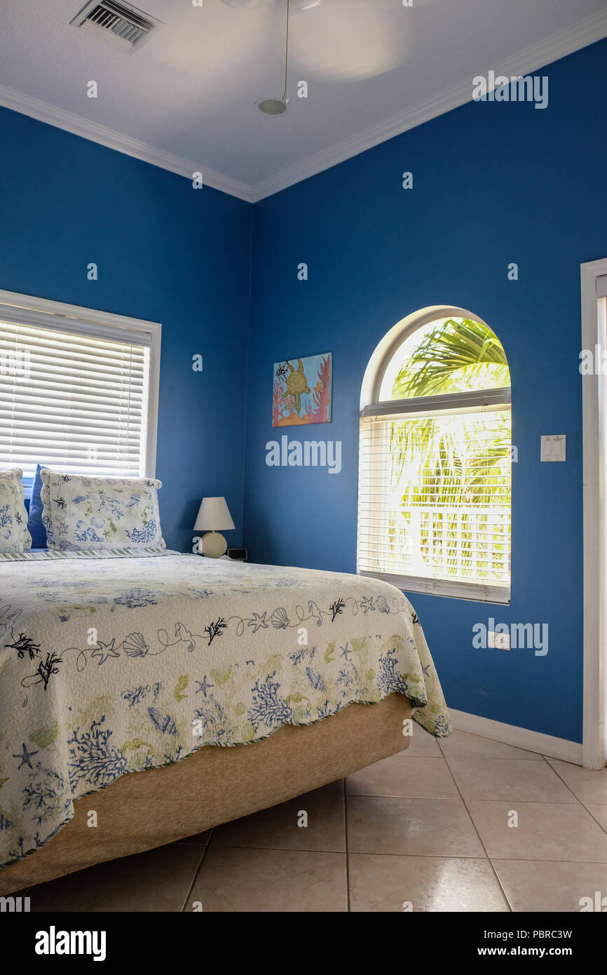 Blue color wall hotel bedroom at Cayman Island Stock Photo ...