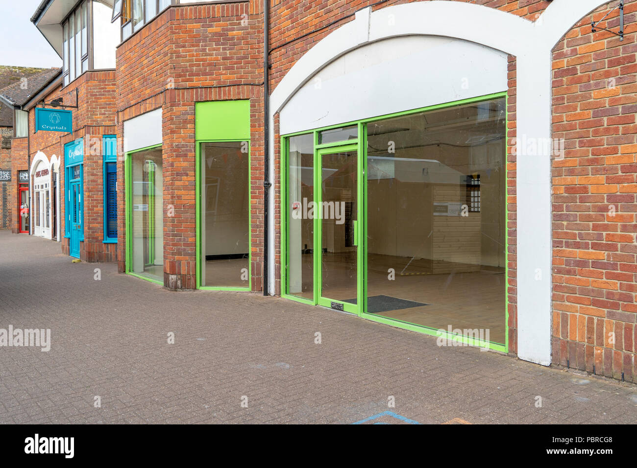 Empty shop with green paintwork - Stock Image