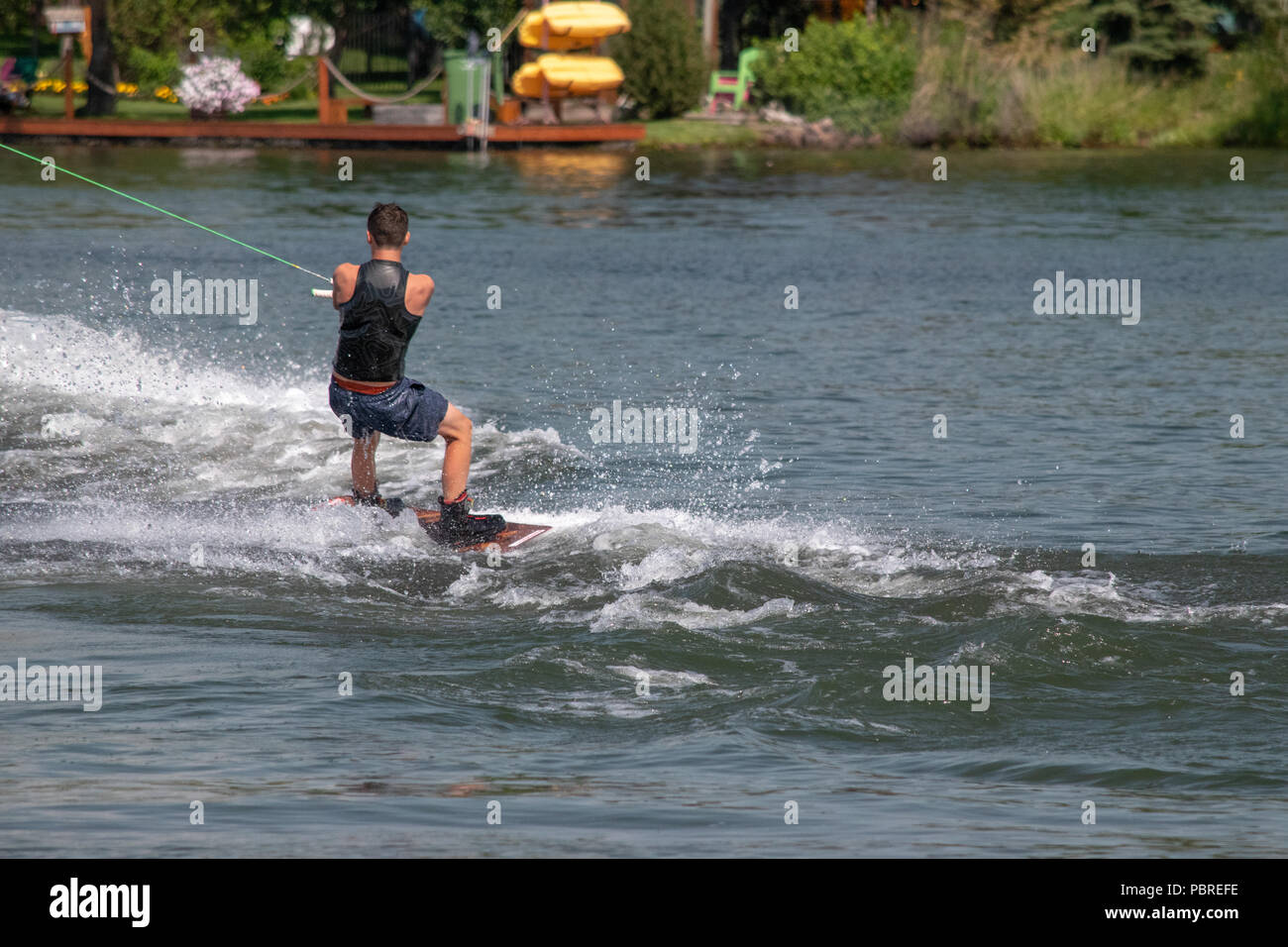 Wakerboarder at the Wakeboarding Competition on Chestermere Lake at the Chestermere Water Festival, Chestermere, Alberta, Canada - Stock Image