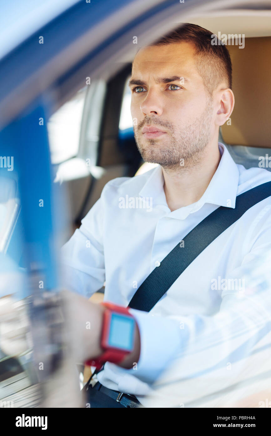Serious young man looking at the road - Stock Image
