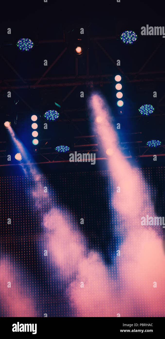Lighting the stage during a musical rock concert and artificial fog. Web banner. - Stock Image