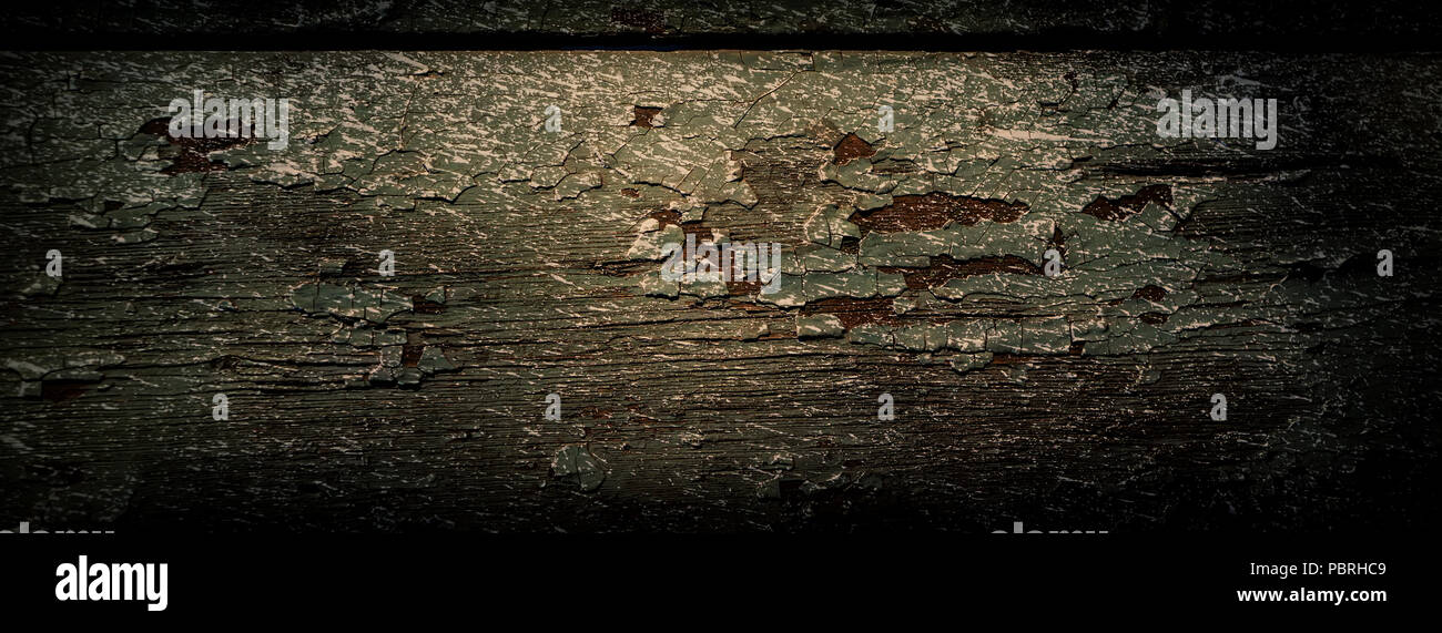 wooden board is covered with old paint and traces of whitewash. Web banner. - Stock Image
