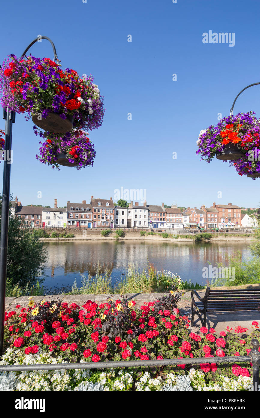 Hanging baskets and flower bedding on the riverside at Bewdley, Worcestershire, England, UK - Stock Image