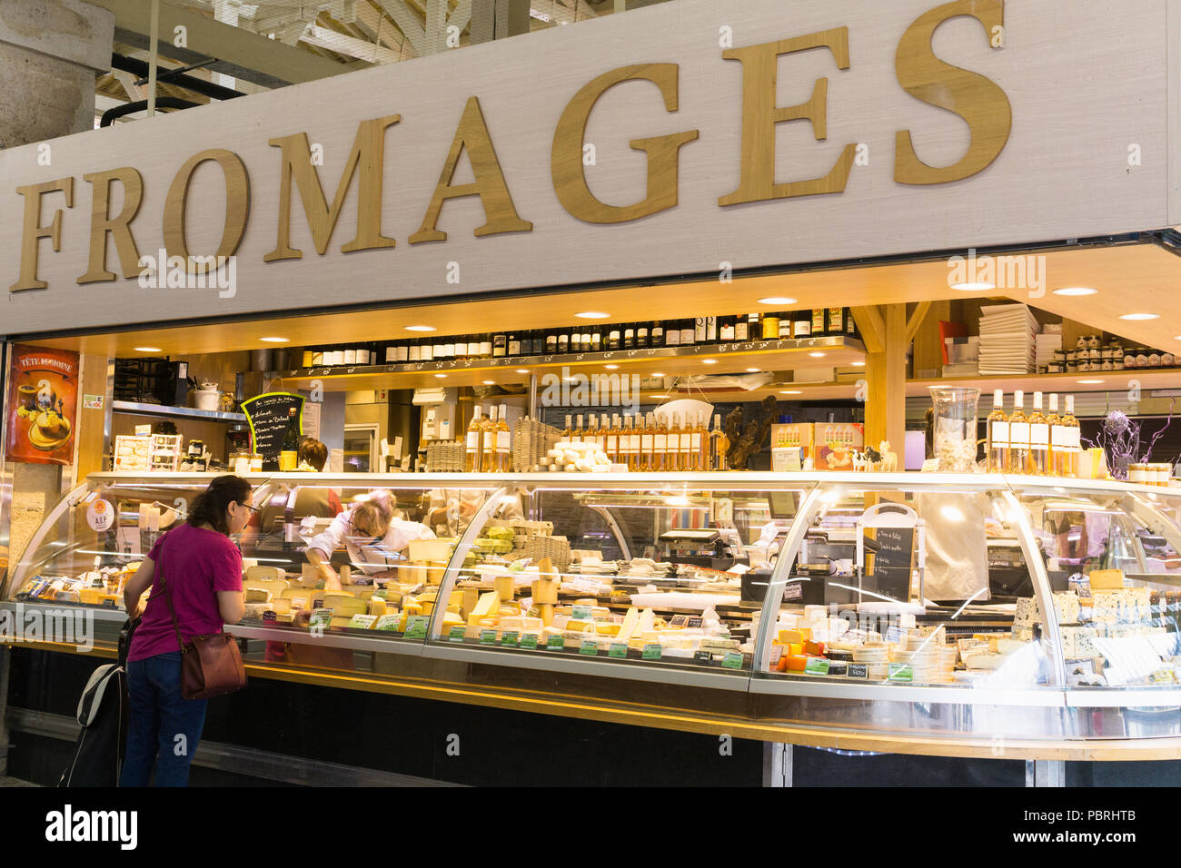 Cheese shop (fromagerie) at Allegri farm market in Paris, France. - Stock Image