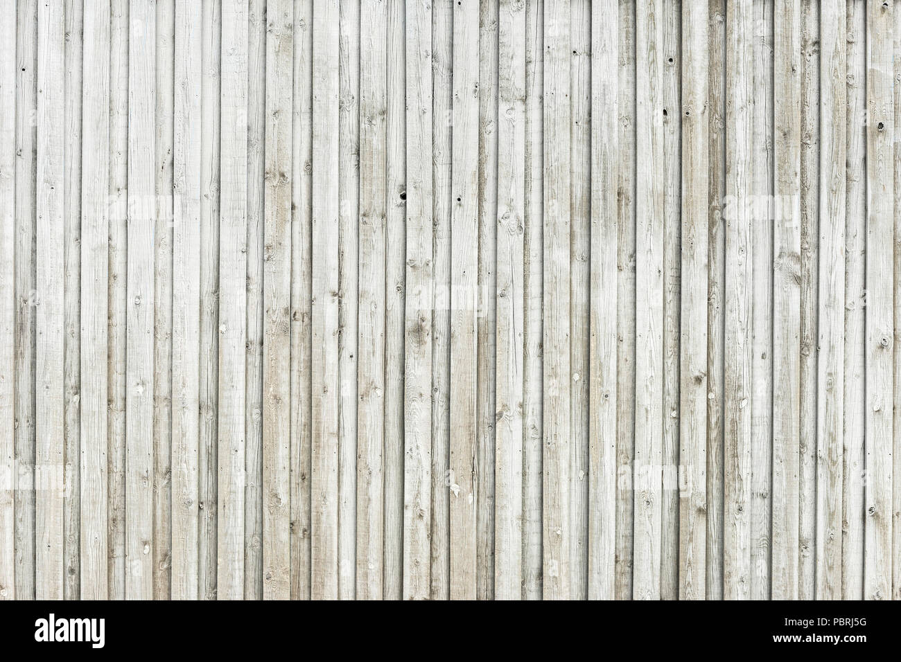 Wooden wall made of horizontally arranged unpainted boards, background image - Stock Image