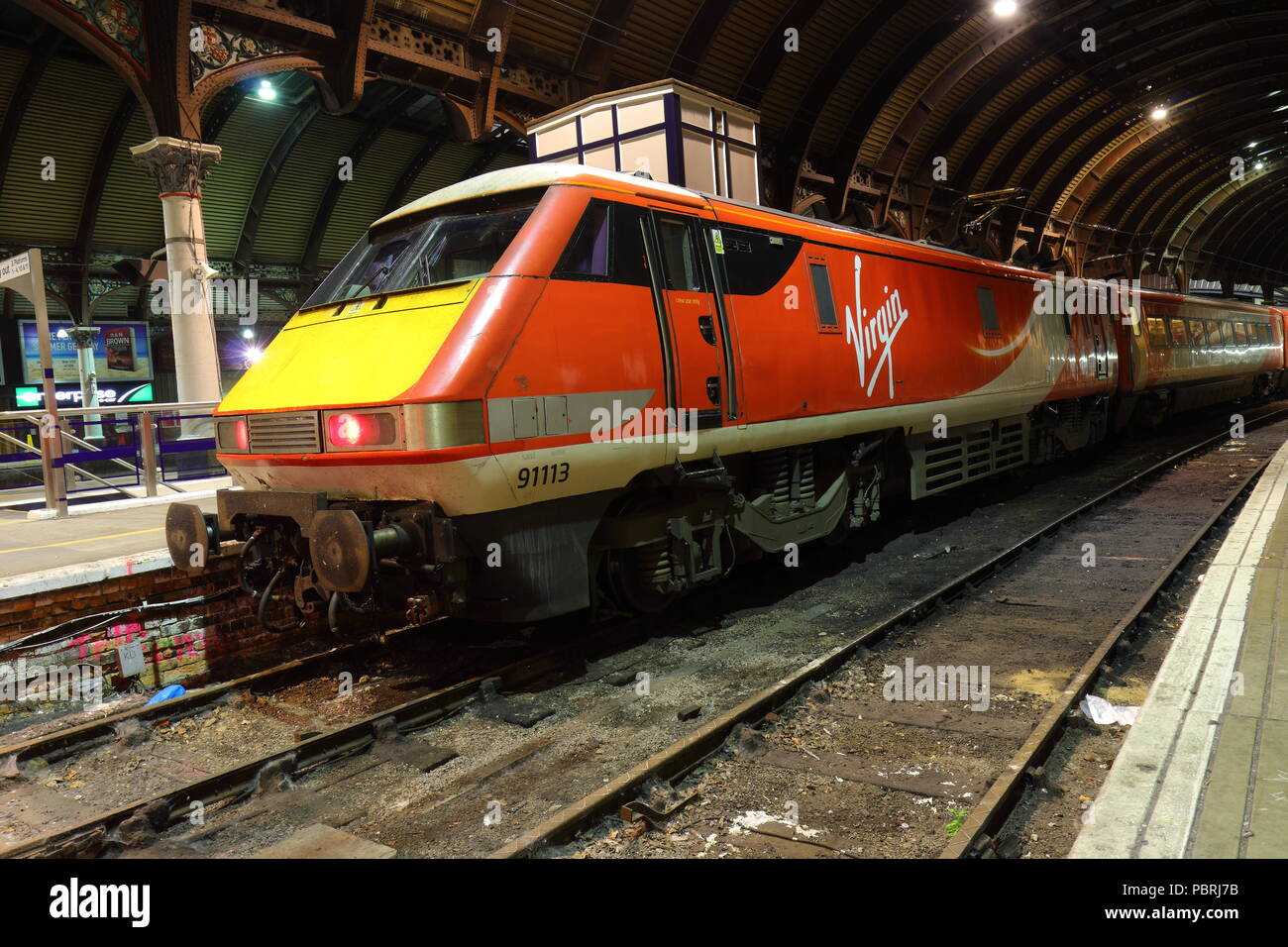 A diesel electric class 91 Virgin train serial number 91113 sits stationary at York Railway Station - Stock Image