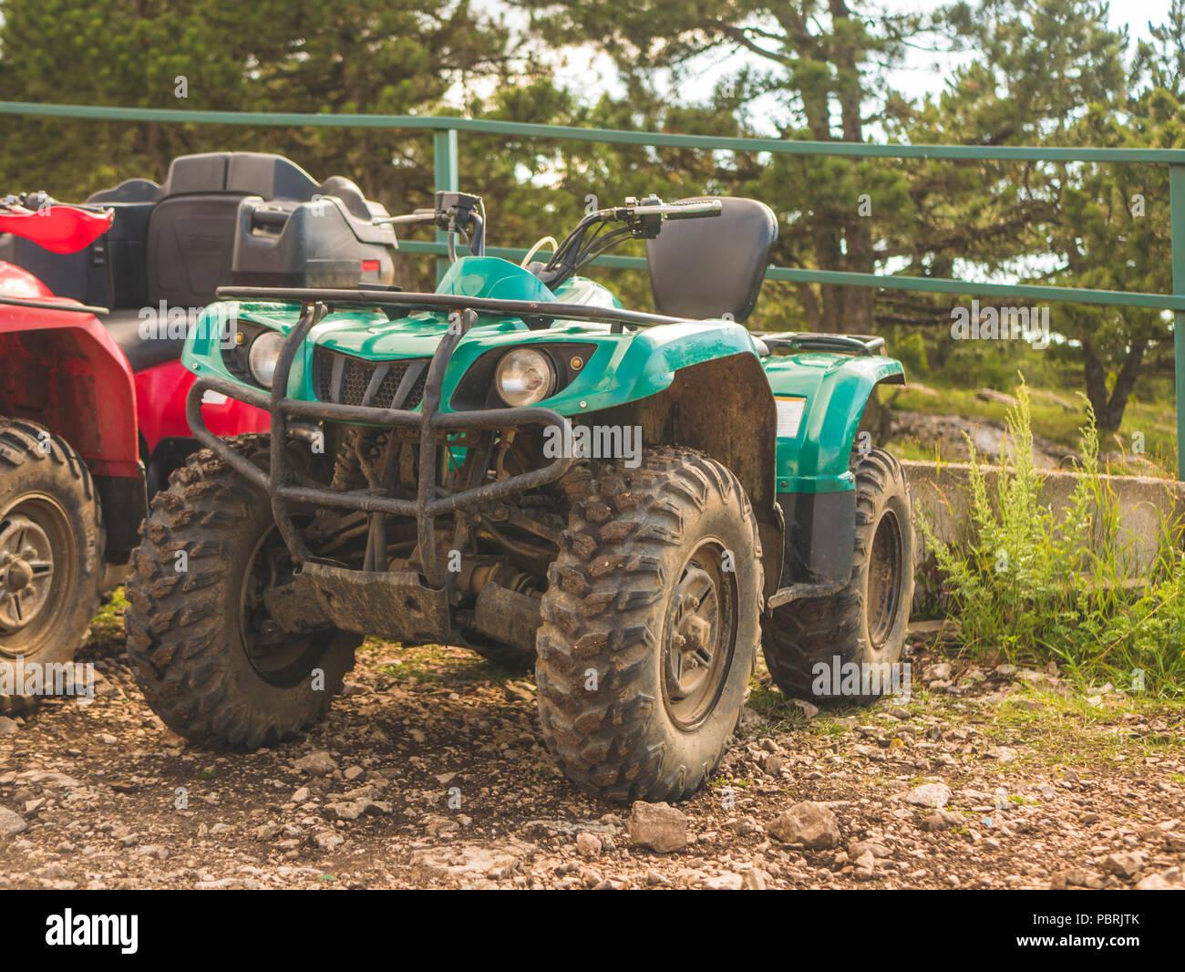 close up atv quad bike on a diry ground summer season - Stock Image