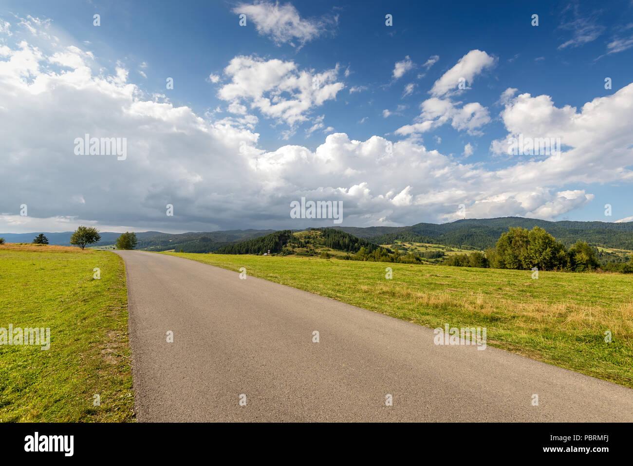 Asphalt road in Pieniny National Park. Malopolska, Poland. - Stock Image