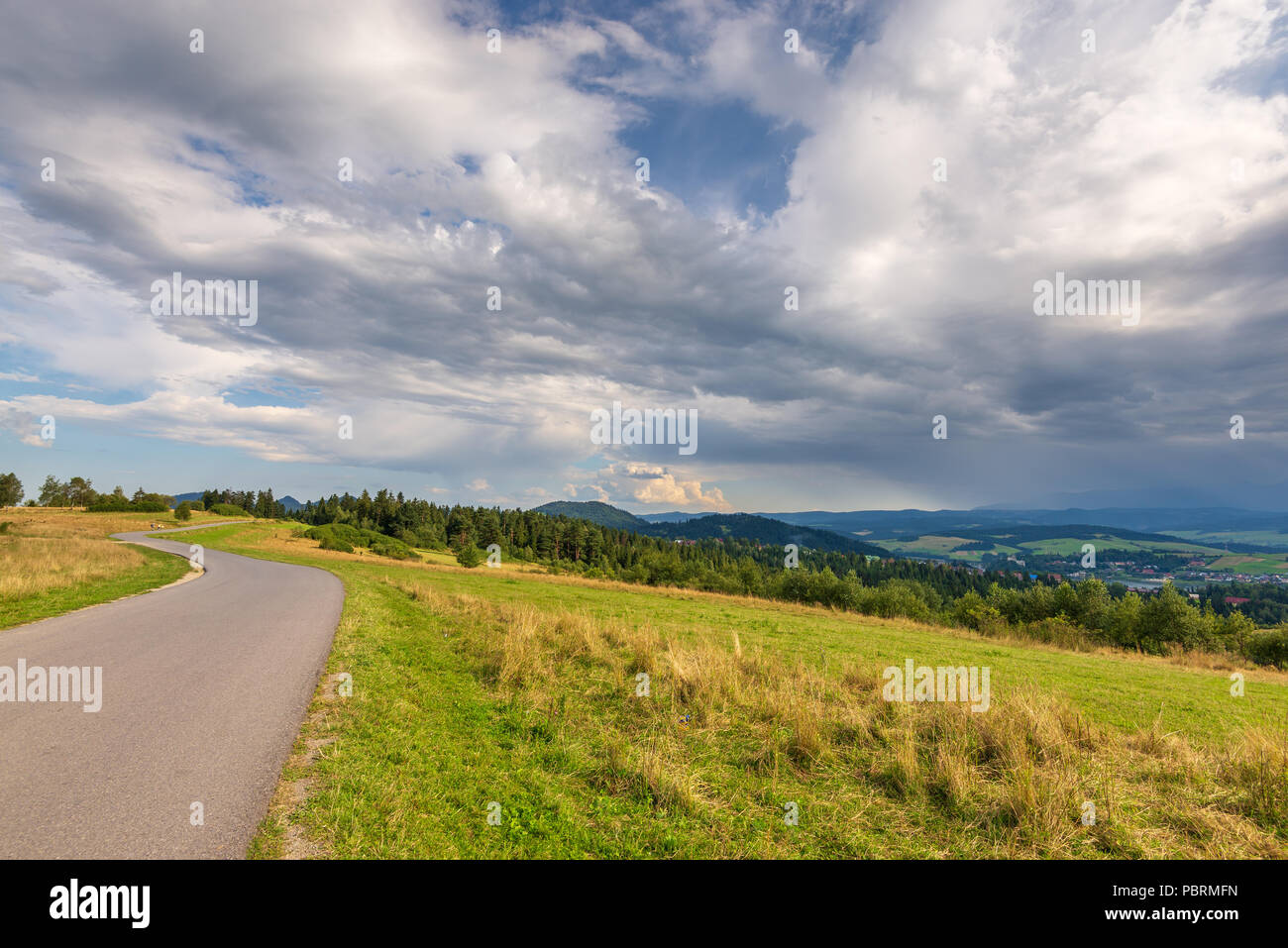Rural scenery. Fields, mountains and clouds on the sky. Pieniny National Park. Malopolska, Poland. - Stock Image