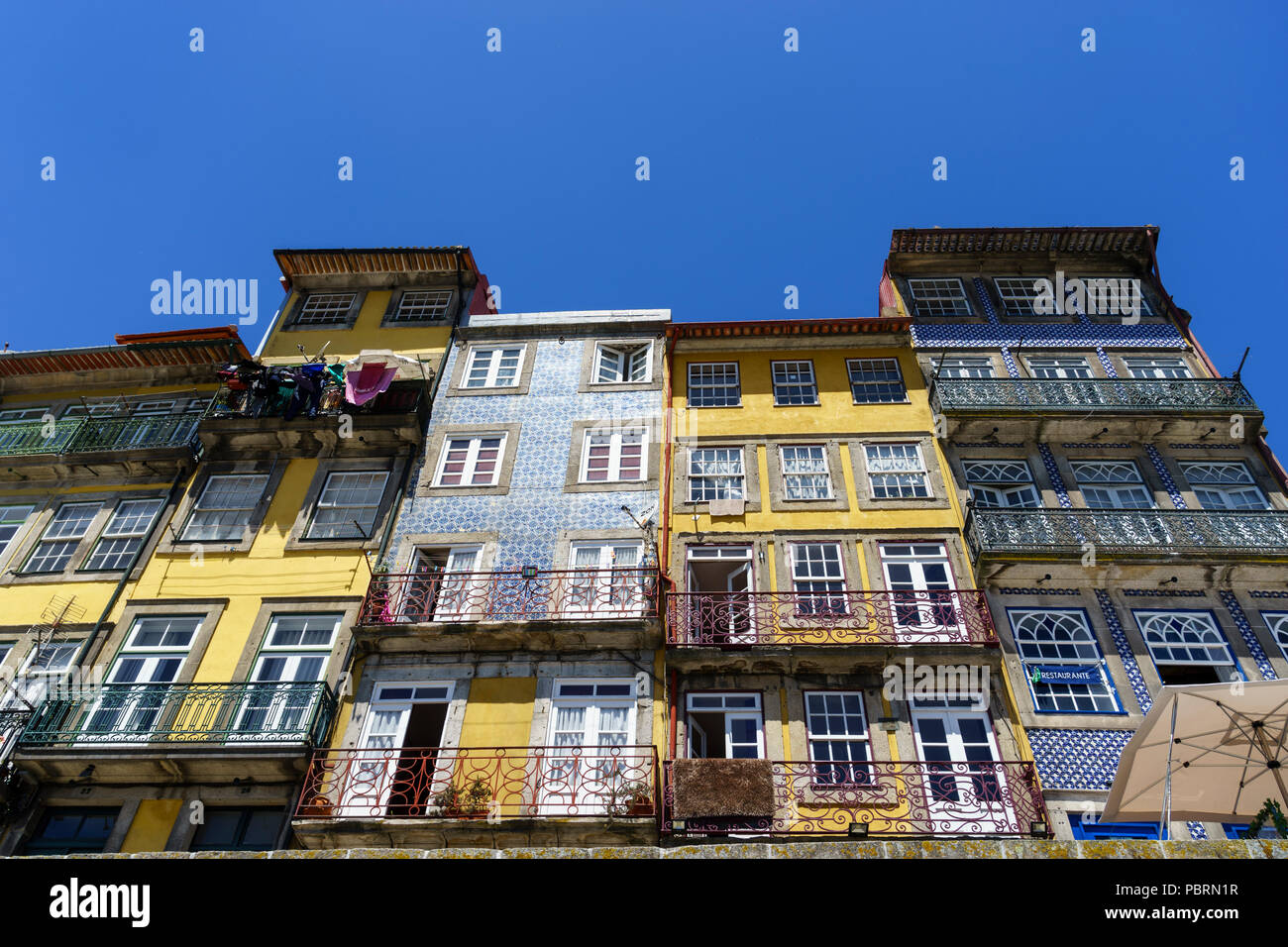 Abstract view of typical multi-story building facades in Porto Portugal showing examples of azulejos tiles - Stock Image