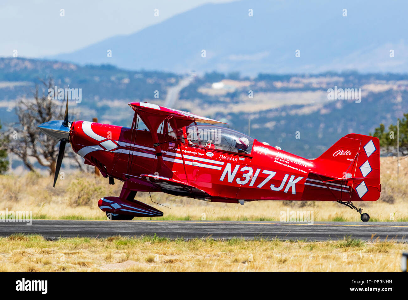 Female pilot, Pitts Special S2C biplane; Metro State University of Denver Aerobatics Team; Salida Fly-in & Air Show; Salida; Colorado; USA - Stock Image