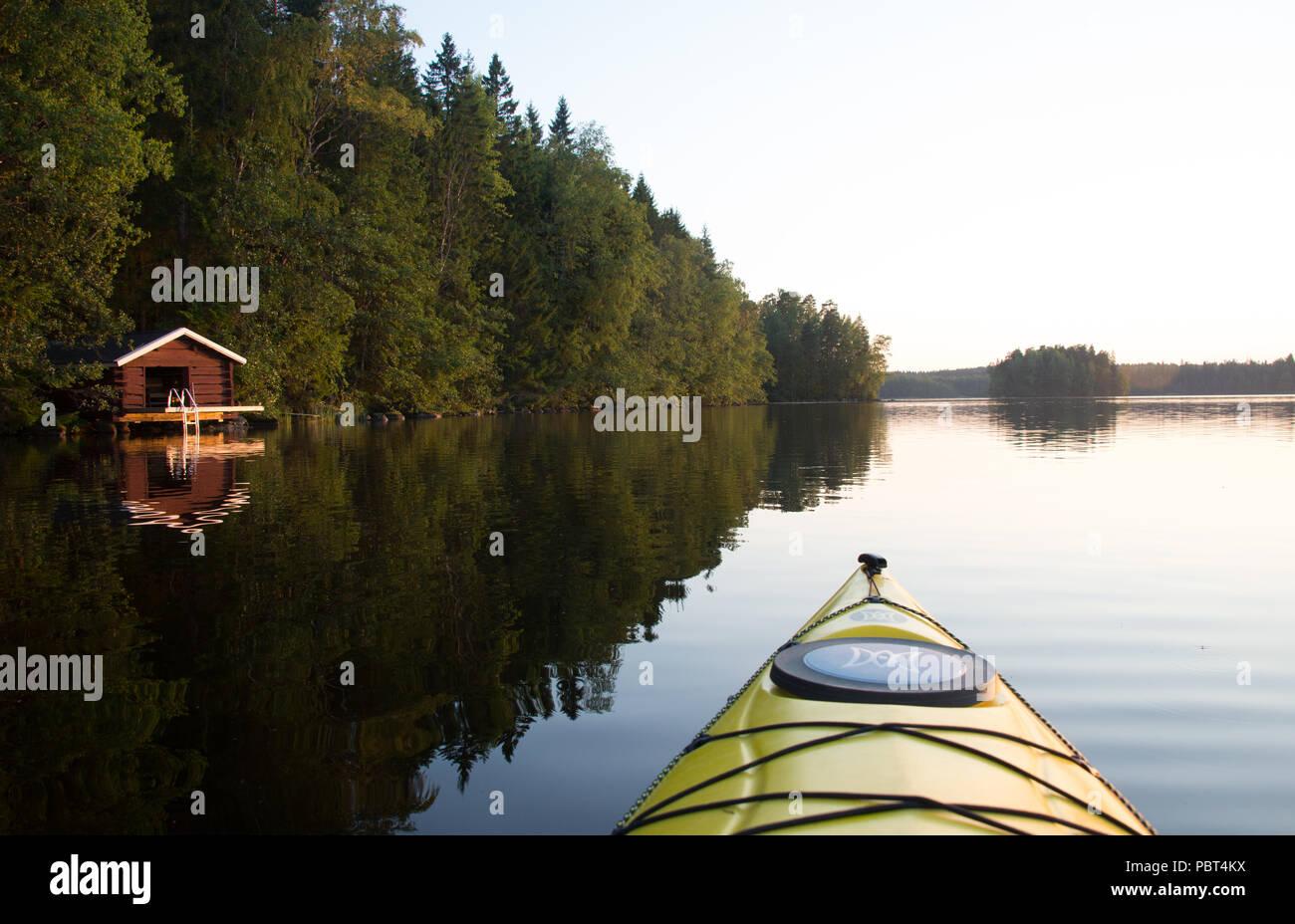 The Beauty of Finnish Summer - Sunset reflections on lake surface. Hausjärvi, Finland. - Stock Image