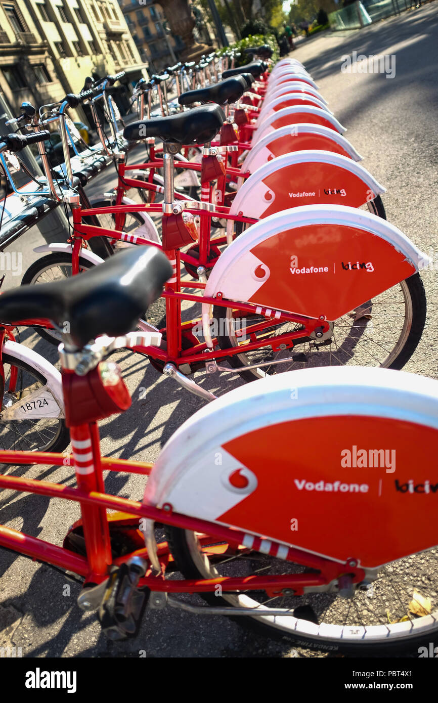 Barcelona bicycle rental scheme for residents only called El Bicing ( Be-Zing ). Sponsored by Vodafone. Barcelona, Spain, Europe. Stock Photo