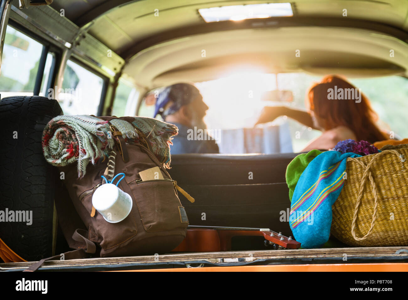 Senior hipster couple going on vacation in a camper van - Stock Image