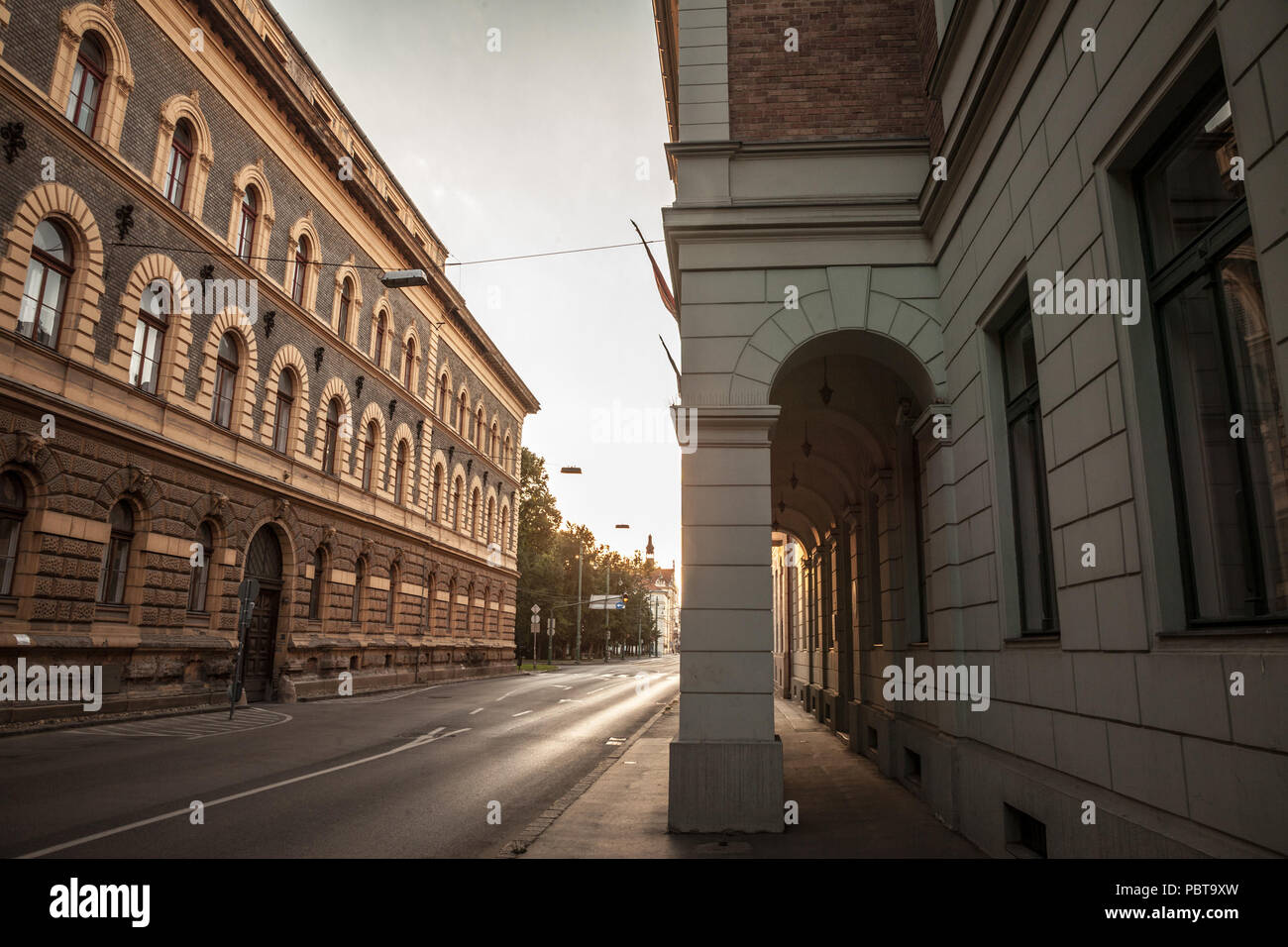 Street of the city center of Szeged, Southern Hungary, surrounded with buildings from the 19th century, with the typical stone architecture of Austro  - Stock Image
