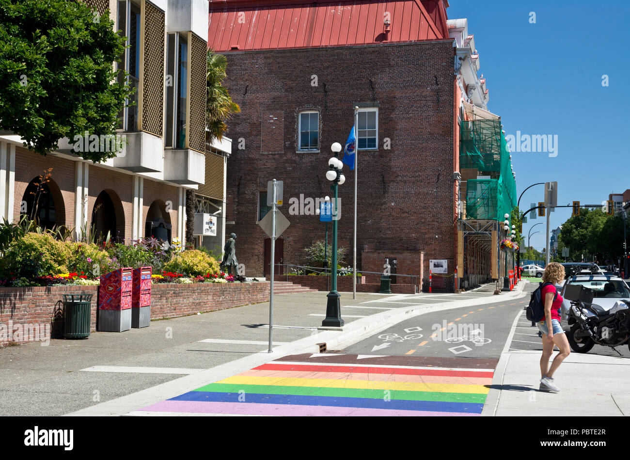 Rainbow crosswalk across bike lanes in downtown Victoria, BC, Canada. - Stock Image