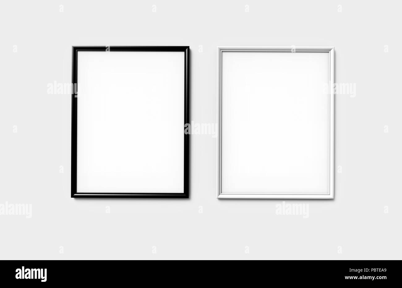 Black and white photo frames with blank copy space hanging on wall ...