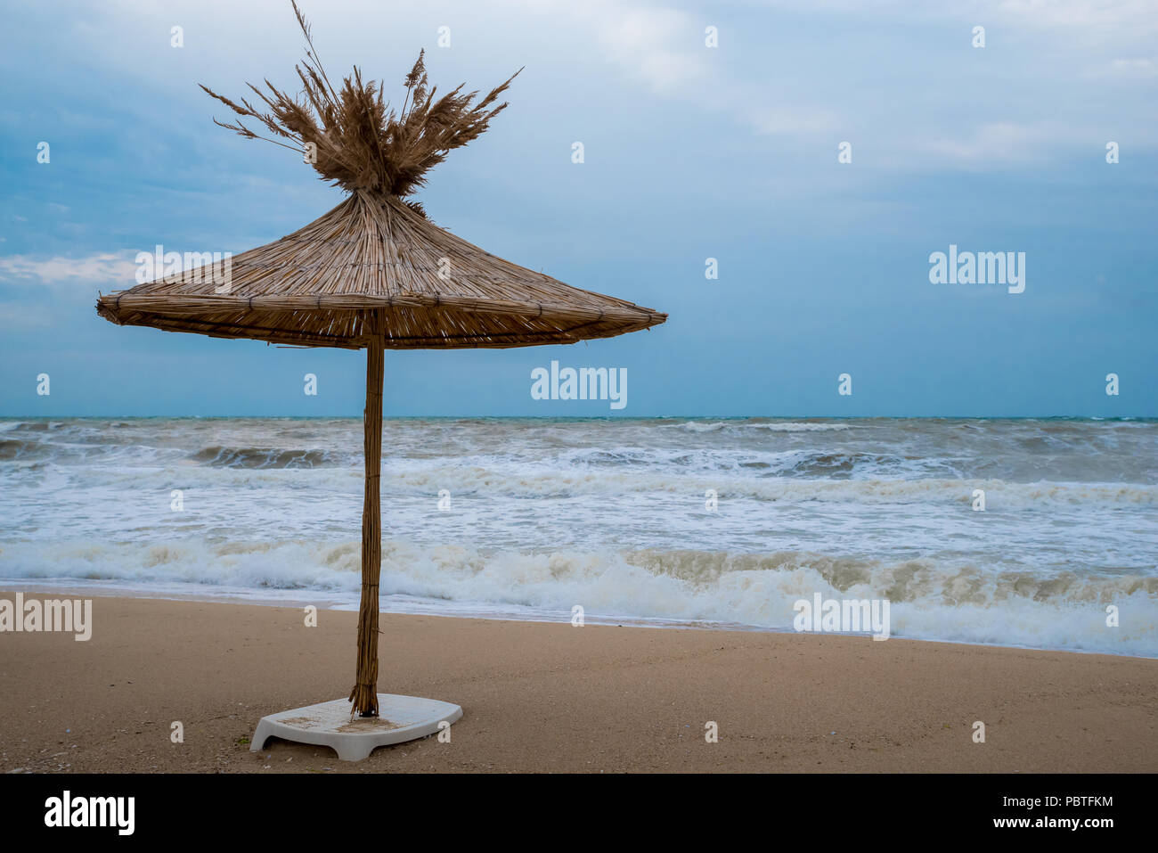 Straw umbrella on a beautiful beach - Europe, Bulgaria. - Stock Image