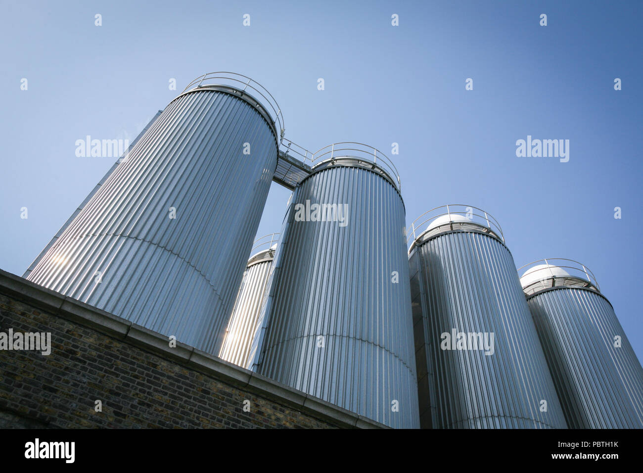 Steel storage containers outside the Guinness brewery in Dublin, Ireland, Europe. Stock Photo