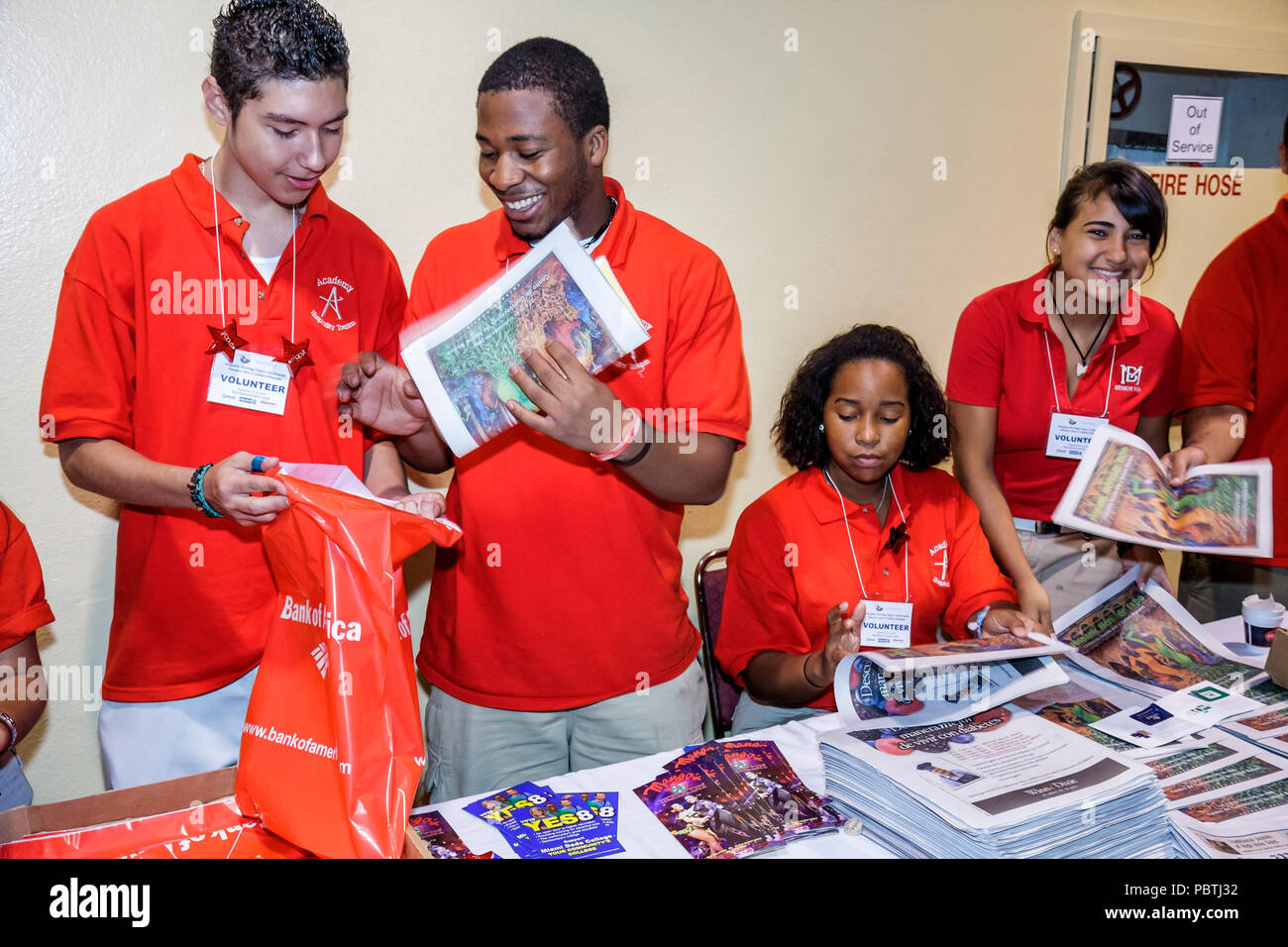 Miami Beach Miami Florida Beach Convention Center Hispanic Heritage Month Expo volunteers Black boy girl teens publications broc - Stock Image