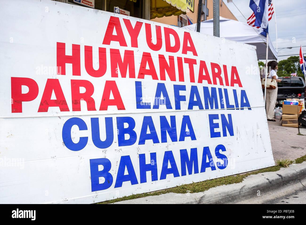 Miami Florida Little Havana Calle Ocho banner activist human rights organization humanitarian aid Cubans Bahamas Spanish languag - Stock Image