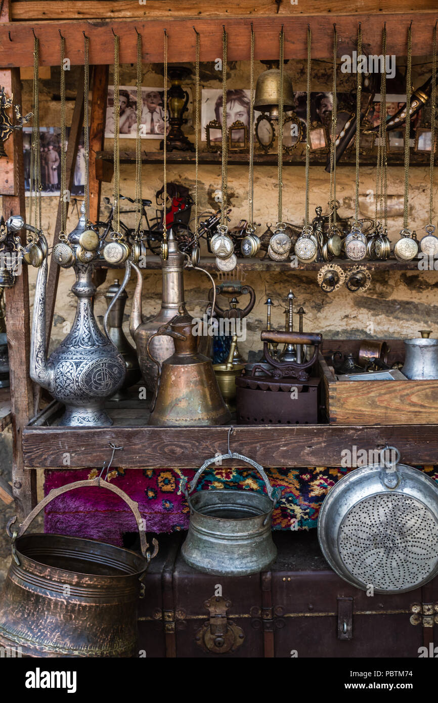 BURSA, TURKEY - CIRCA 2017: Handmade antique objects, forged copper jugs and buckets, cast irons and chained pocket watchs Stock Photo