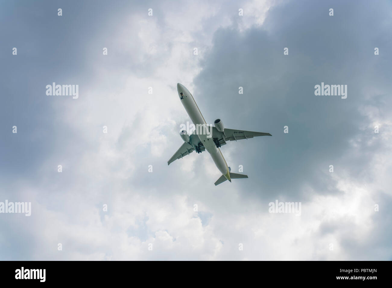 Singapore - June 03 2018: Airliner on final approach into Changi Airport Stock Photo